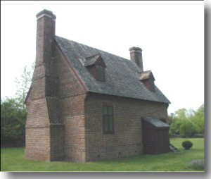 Photo of a typical four-on-four colonial house with 2 chimneys
